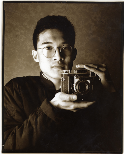 George Ong photographer with Super Ikonta camera